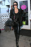 Paris Hilton shows great cleavage wearing black top and push-up bra as she leaves The MySpace Music Cafe and walks Main Street during 2009 Sundance Film Festival - Hot Celebs Home